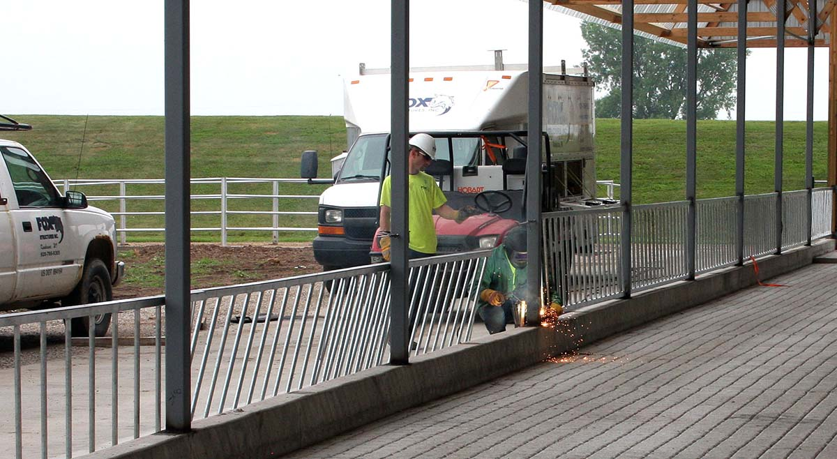 Fox Structures working on a custom railing on a calf source agricultural building