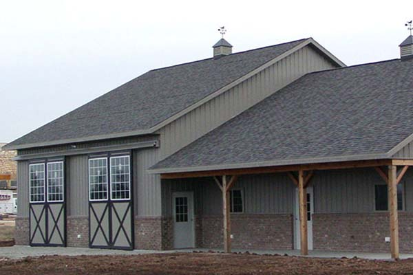 custom equestrian style horse barn in Freedom, WI. Designed and built by Fox Structures