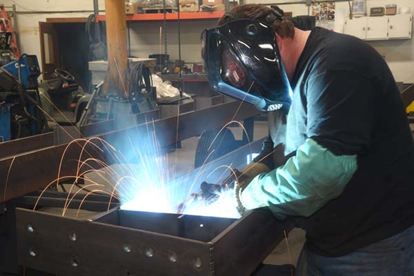 Fox Structures employee working on a custom welding project