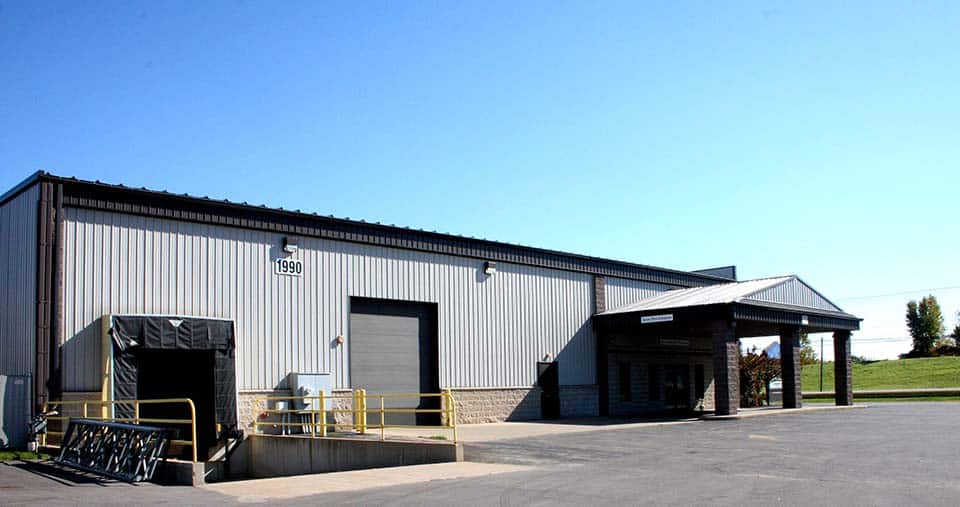 Exterior view of the loading dock and overhead door at the Clean Water Testing building by Fox Structures
