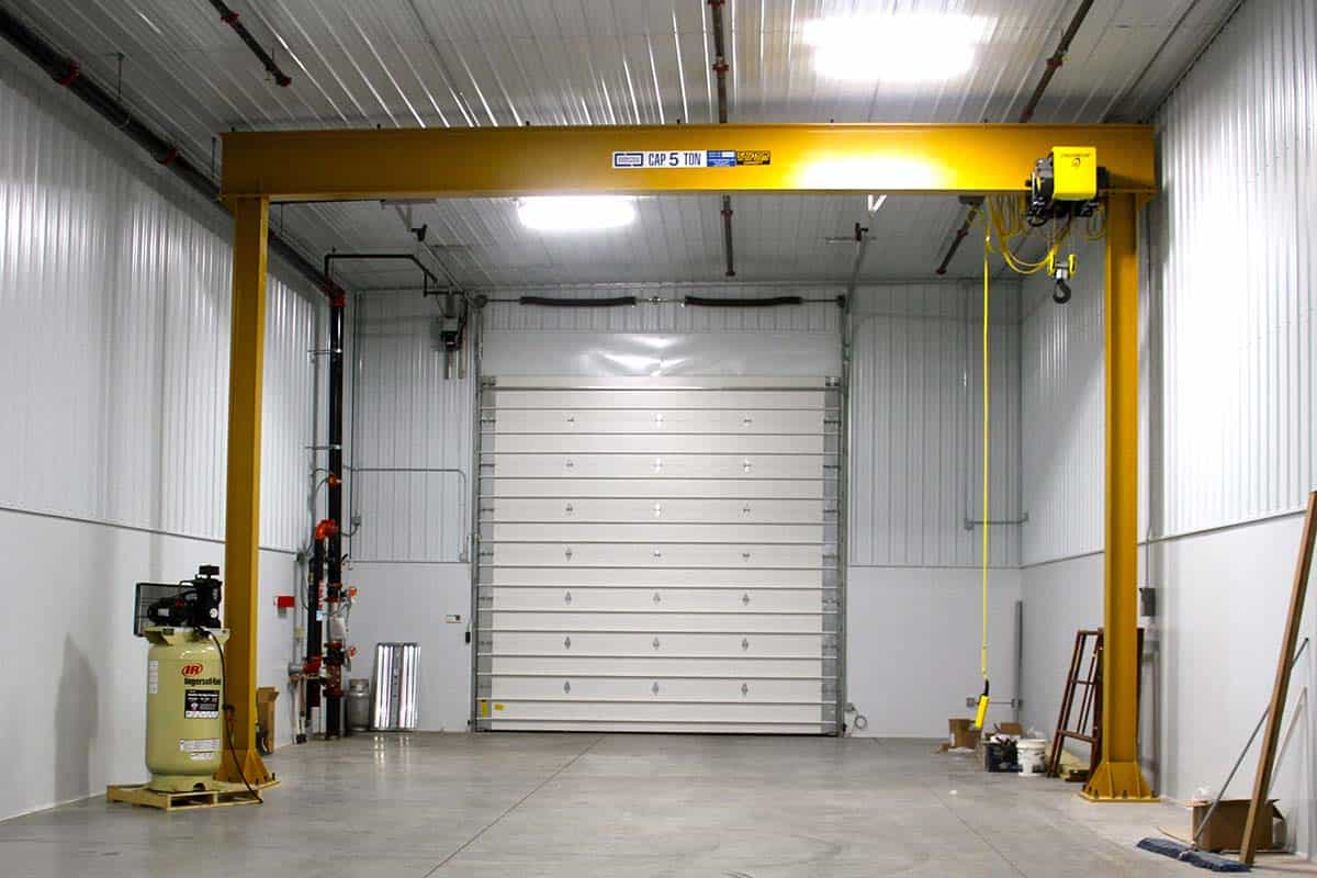 Large 5 ton capacity lift in the large garage in the back of the Clean Water building by Fox Structures