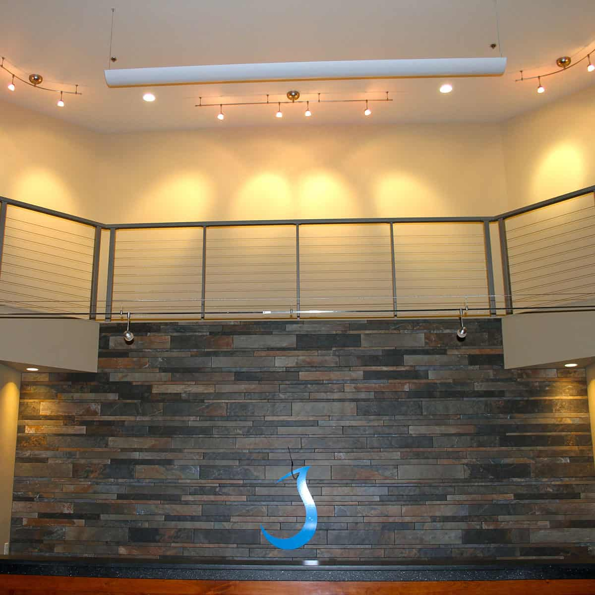 Front reception area with lit up second story area above