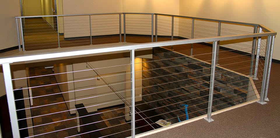 Metal handrail on the second story of the Clean Water building by Fox Structures