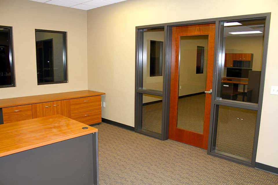 Office doorway with big open windows looking into the hallway of the Clean Water building by Fox Structures
