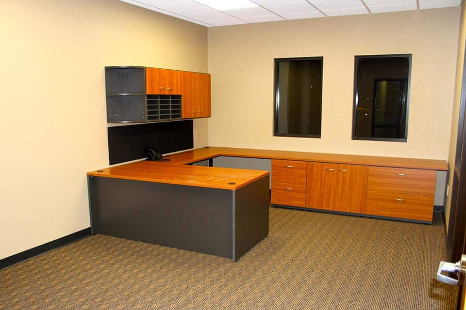 Empty office desk of a newly built office space in the Clean Water building by Fox Structures