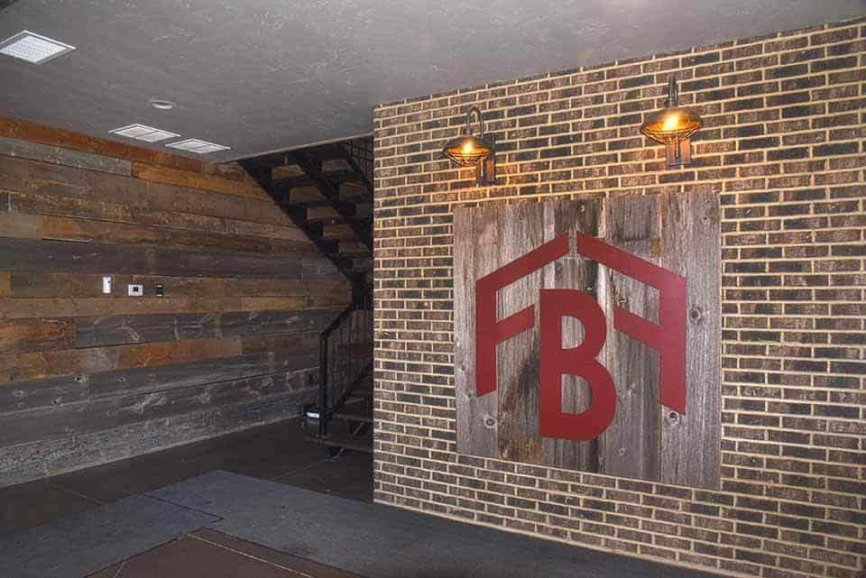 FBF wooden mural on entryway wall of the Forest Brook Farms building by Fox Structures
