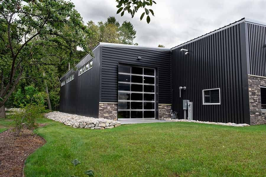 Back exterior view of Troy and Gail Temme's Waterfront Workshop, commercial building in Sturgeon Bay, WI