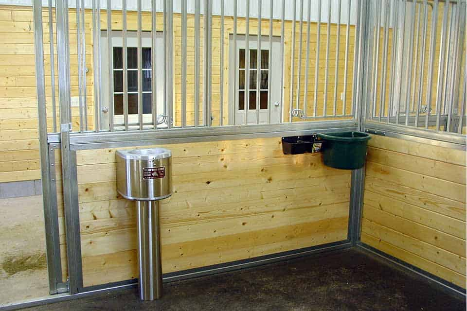 Equestrian Construction in Freedom, WI, inside horse stall with built-in water and food containers for the horses