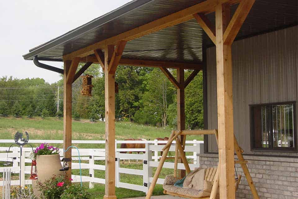 Equestrian Construction in Appleton, WI, covered front porch area with wooden swing and landscaping