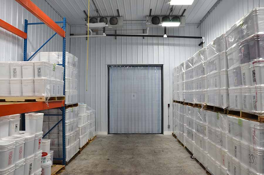commercial construction in Appleton, WI, refrigerated storage area with packaged cranberries ready to be shipped